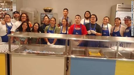 Leanne Carrasco and her friends pose after serving pizza to some 200 homeless women and children.