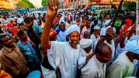 Sudanese supporters of the ruling Transitional Military Council chant slogans during a rally in the capital Khartoum on May 31.