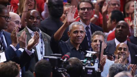Former President Barack Obama waves to the crowd during Game 2 of the NBA Finals Sunday night.