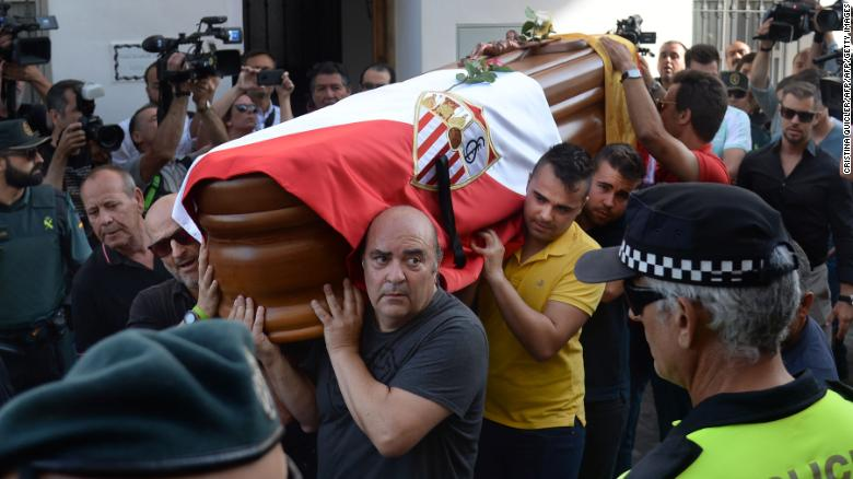 Reyes' coffin, covered with the flags of the village of Utrera and Sevilla FC, was carried through his hometown.