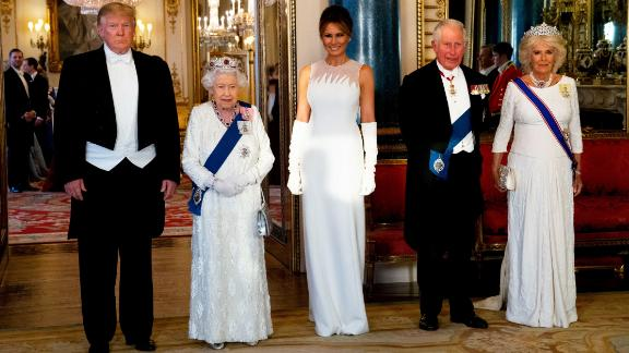 Britain's Queen Elizabeth II (2L), US President Donald Trump (L), US First Lady Melania Trump (C), Britain's Prince Charles, Prince of Wales (2R) and Britain's Camilla, Duchess of Cornwall pose for a photograph ahead of a State Banquet in the ballroom at Buckingham Palace in central London on June 3, 2019, on the first day of the US president and First Lady's three-day State Visit to the UK. - Britain rolled out the red carpet for US President Donald Trump on June 3 as he arrived in Britain for a state visit already overshadowed by his outspoken remarks on Brexit. (Photo by Doug Mills / POOL / AFP)        (Photo credit should read DOUG MILLS/AFP/Getty Images)