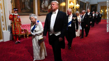 Britain's Queen Elizabeth II (L) walks with US President Donald Trump (C) and other guests as they arrive through the East Gallery during a State Banquet in the ballroom at Buckingham Palace in central London on June 3, 2019, on the first day of the US president and First Lady's three-day State Visit to the UK. - Britain rolled out the red carpet for US President Donald Trump on June 3 as he arrived in Britain for a state visit already overshadowed by his outspoken remarks on Brexit. (Photo by Victoria Jones / POOL / AFP)        (Photo credit should read VICTORIA JONES/AFP/Getty Images)