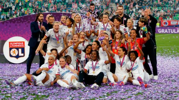 Lyon celebrates beating Barcelona in Budapest.