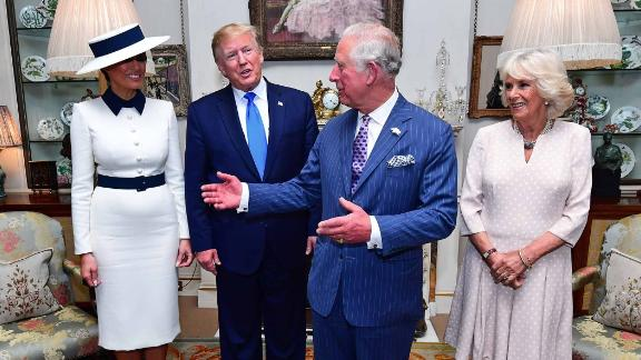 The Trumps are welcomed in London by Charles and Camilla.