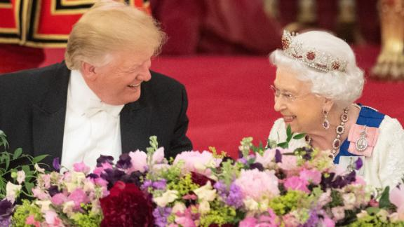 Trump and the Queen laugh during the state banquet.