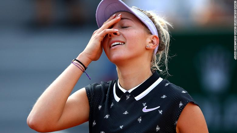 Anisimova reacts to defeating Halep in Paris.
