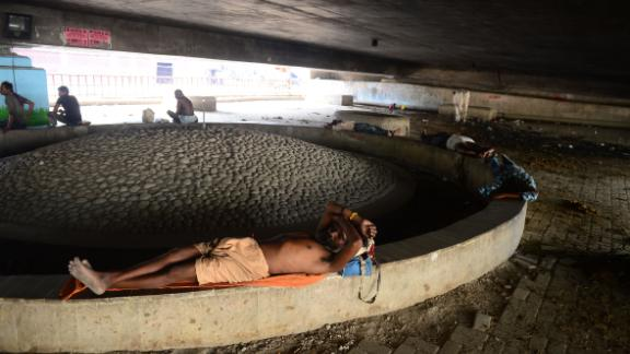 An Indian man rests under a bridge during a hot summer afternoon in Allahabad on Sunday, June 2.