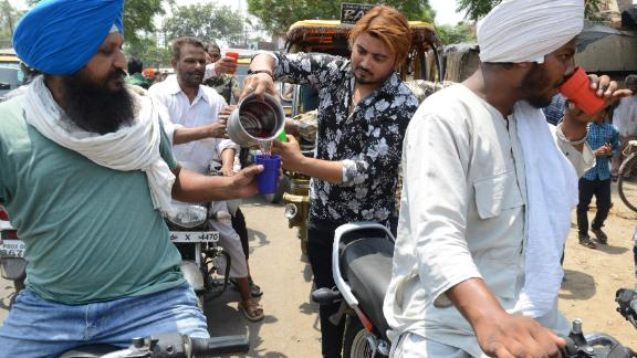 Indian volunteers distribute sweet water during a hot summer day, in Amritsar on Sunday, June 2.