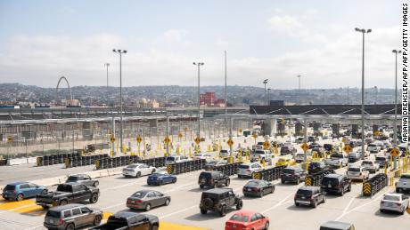 Cars pass from the US into Mexico at the border crossing in San Ysidro, California on May 31, 2019. - President Donald Trump escalated his abrupt tariff threats against Mexico, triggering alarm about the likely economic fallout, spooking global markets and raising the prospect of US trade wars on multiple fronts. Trump unexpectedly announced his readiness to levy tariffs on all Mexican imports, beginning at five percent starting June 10 and rising monthly to as high as 25 percent until Mexico substantially reduces the flow of illegal immigration. (Photo by ARIANA DREHSLER / AFP)        (Photo credit should read ARIANA DREHSLER/AFP/Getty Images)