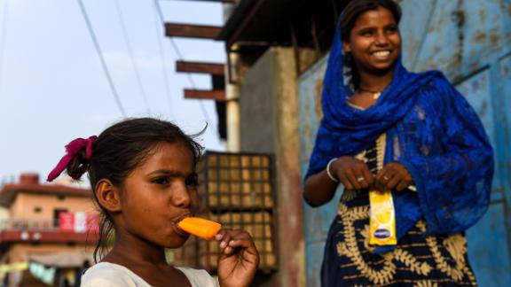 An Indian girl eats an ice lolly during a hot day in Churu in Rajastahn on Monday, June 3.