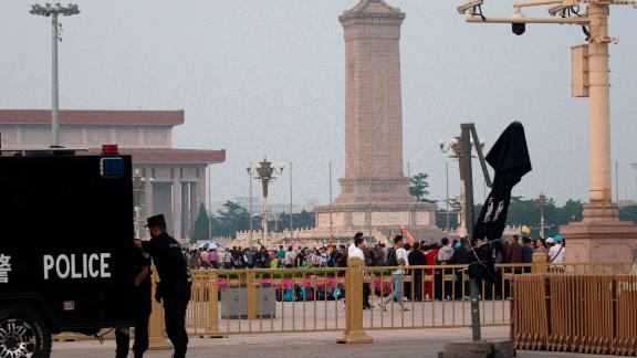 """Visitors gather around the Monument to the People's Heroes on Tiananmen Square during the 30th anniversary of a bloody crackdown of pro-democracy protesters in Beijing on Tuesday, June 4, 2019. Critics say the 1989 Tiananmen crackdown, which left hundreds, possibly thousands, dead, set the ruling Communist Party on its present course of ruthless suppression, summary incarceration and the frequent use of violence against opponents in the name of """"stability maintenance."""" (AP Photo/Ng Han Guan)"""