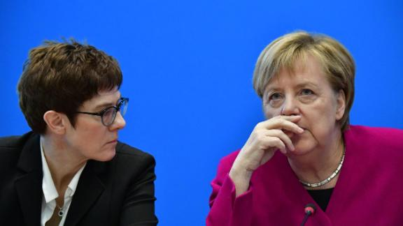 German Chancellor and leader of the Christian Democratic Union (CDU) Angela Merkel (R) talks with Secretary General of the Christian Democratic Union (CDU) Annegret Kramp-Karrenbauer prior a CDU leadership meeting at the CDU headquarters on October 29, 2018 in Berlin, a day after her fragile coalition suffered heavy losses in a key regional election. - German Chancellor Angela Merkel will not stand again as leader of her centre-right CDU, a party source told AFP, making way after 18 years for a successor following a series of regional vote defeats. (Photo by Tobias SCHWARZ / AFP)        (Photo credit should read TOBIAS SCHWARZ/AFP/Getty Images)