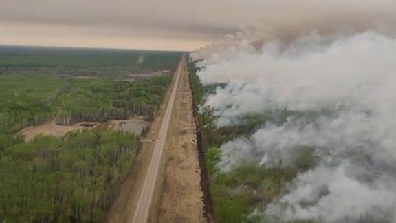 Smoke rises from a wildfire in High Level, Alberta, Canada, on May 22.