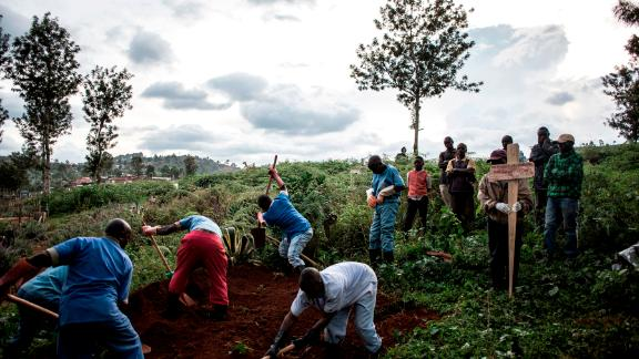 Family members  watch the deceased victim of the Ebola virus being buried on May 16, 2019 in Butembo. The city of Butembo is at the epicentre of the Ebola crisis in the DR Congo.