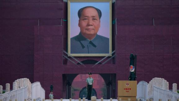 A Chinese paramilitary police officer stands guard in front of Mao Zedong's portrait on Beijing's Tiananmen Gate on Tuesday.