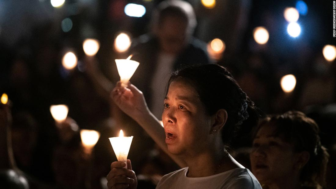 "Tens of thousands filled Victoria Park on Tuesday, ignoring sweltering heat and threatening clouds overhead. Most wore black and almost all held candles overhead. The crowd chanted: ""Demand accountability for the massacre! End one-party dictatorship! Build a democratic China!"""