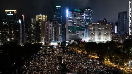 People attend a candlelight vigil at Victoria Park in Hong Kong on June 4, 2019, to mark the 30th anniversary of the 1989 Tiananmen crackdown in Beijing. - The semi-autonomous financial hub has hosted an annual vigil every year since tanks and soldiers smashed into protesters near Beijing's Tiananmen Square on June 4, 1989 -- an illustration of the city's unusual freedoms and vibrant political scene.