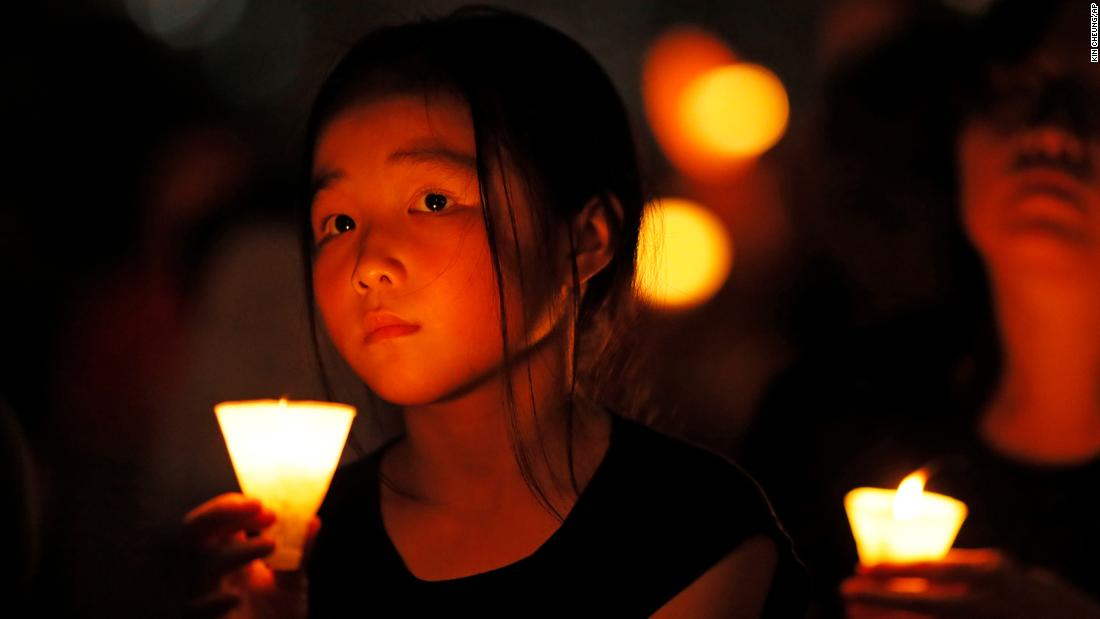A candlelight vigil, held in Hong Kong's Victoria Park on Tuesday, remembered the victims of the 1989 massacre in Beijing's Tiananmen Square.