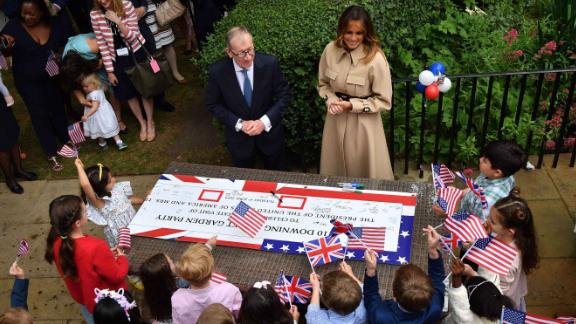 Philip May and Melania Trump attend a garden party at No. 10 Downing Street.