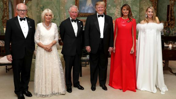 The Trumps pose for a photo ahead of a dinner at Winfield House in London on Tuesday, June 4. Joining them, from left, are Woody Johnson, the US ambassador to the United Kingdom; Camilla, the Duchess of Cornwall; Prince Charles; and Johnson