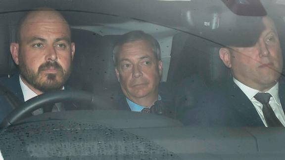 Brexit Party leader Nigel Farage, center, arrives at Winfield House, where the Trumps are staying during their visit.