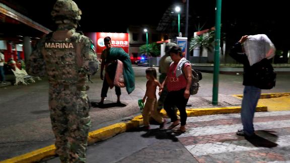 A Mexican marine stands by as camping migrant families are evicted from a park in Tapachula on May 29.