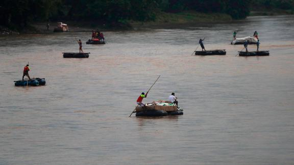 Rafts criss-cross the Suchiate river on the Guatemala -- Mexico border, near Ciudad Hidalgo, Mexico, on May 31, 2019.