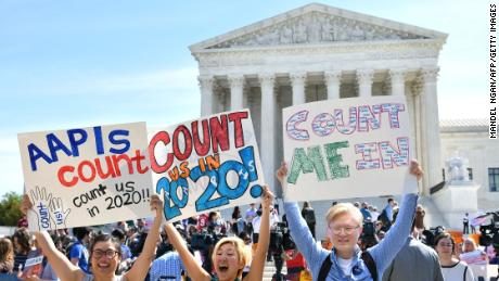 Demonstrators rally at the US Supreme Court in Washington, DC, on April 23, 2019, to protest a proposal to add a citizenship question in the 2020 Census. - In March 2018, US Secretary of Commerce Wilbur Ross announced he was going to reintroduce for the 2020 census a question on citizenship abandoned more than 60 years ago. The decision sparked an uproar among Democrats and defenders of migrants -- who have come under repeated attack from an administration that has made clamping down on illegal migration a hallmark as President Donald Trump seeks re-election in 2020. (Photo by MANDEL NGAN / AFP)        (Photo credit should read MANDEL NGAN/AFP/Getty Images)