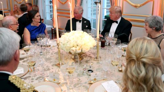 White House Press Secretary Sarah Huckabee Sanders, (2L), Britain's Prince Charles , Prince of Wales (C), US President Donald Trump (2R) and Britain's Prime Minister Theresa May attend a dinner Winfield House, the residence of the US Ambassador, where US President Trump is staying whilst in London, on June 4, 2019, on the second day of the US President's three-day State Visit to the UK.