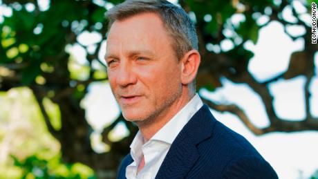 "FILE - In this April 25, 2019, file photo, actor Daniel Craig poses for photographers during the photo call of the latest installment of the James Bond film franchise, currently known as ""Bond 25,"" in Oracabessa, Jamaica. An explosion Tuesday, June 4, 2019, on the set of the new James Bond movie has injured one crew member and damaged a stage at Pinewood Studios outside London. No one was injured on set but a crew member outside the stage sustained a minor injury. The exterior of a stage was also damaged at the studio facilities. (AP Photo/Leo Hudson, File)"