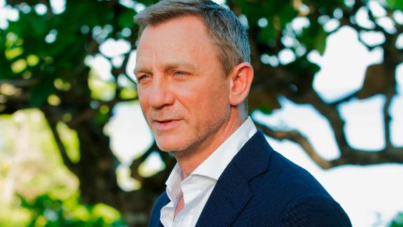 """FILE - In this April 25, 2019, file photo, actor Daniel Craig poses for photographers during the photo call of the latest installment of the James Bond film franchise, currently known as """"Bond 25,"""" in Oracabessa, Jamaica. An explosion Tuesday, June 4, 2019, on the set of the new James Bond movie has injured one crew member and damaged a stage at Pinewood Studios outside London. No one was injured on set but a crew member outside the stage sustained a minor injury. The exterior of a stage was also damaged at the studio facilities. (AP Photo/Leo Hudson, File)"""