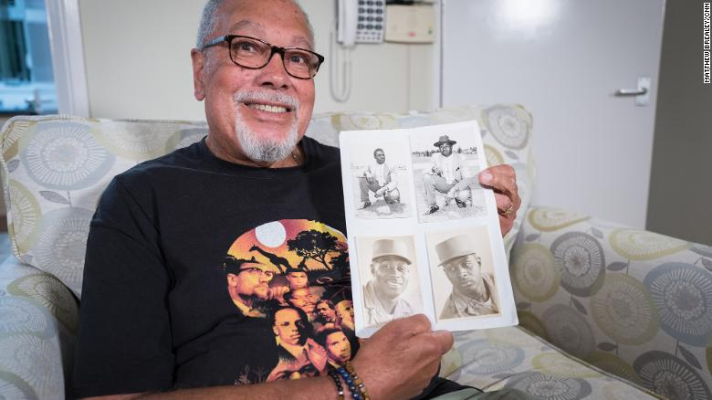 Dave Greene with photographs of his father, who was serving as a photographer in the US Army when he met Dave's mother during World War II. Her family would not let her move to the US.