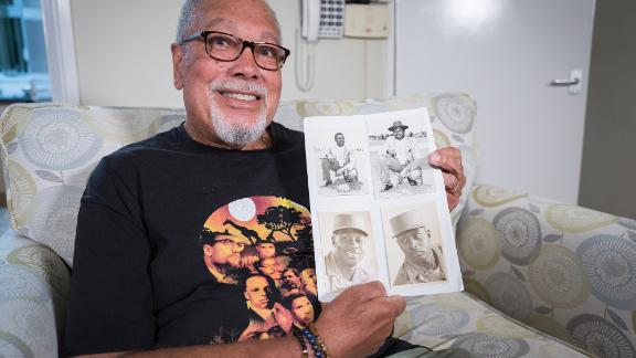 Dave Greene with photographs of his father, who was serving as a photographer in the US Army when he met Dave