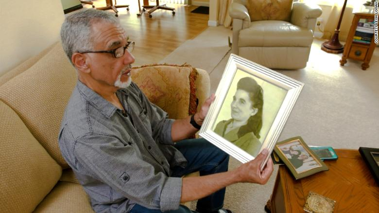 Leon Lomax with a photograph of his mother. He is haunted by the question of why she gave him up.