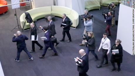 In this image made from video, Australia's Federal Police, top, enter the Australian Broadcasting Corporation, the national public broadcaster, during a raid on their offices in Sydney, Australia. The Federal Police raided the offices in connection to a 2017 story based on leaked military documents that indicated the country's military forces were being investigated for some of their actions in Afghanistan. (Australian Broadcasting Corporation via AP)