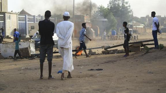 Locals set tyres on fire and block a side street leading to their neighborhood in the Sudanese capital Khartoum to stop military vehicles from driving through the area on June 4, 2019.
