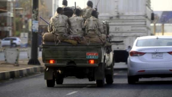 Sudanese security forces ride in the back of a pick up truck through a main avenue in Khartoum as the military continued to disperse protesters by force in Sudan's capital on June 4, 2019.