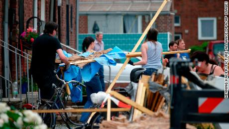 Residents clear away debris Wednesday after a tornado ripped through Bocholt, Germany.