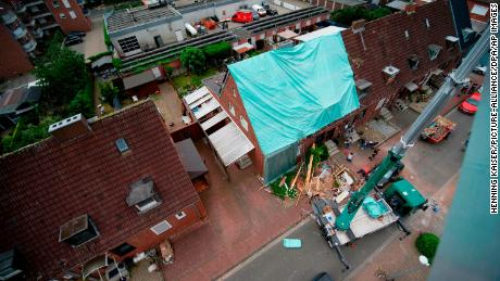 A tarp covers a damaged roof Wednesday in Bocholt in the wake of the storm.