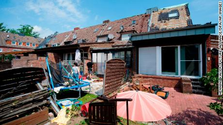 The remains of a roof lie in the garden of a property Wednesday in Bocholt.