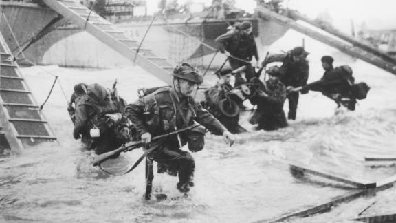 Troops from the 48th Royal Marines disembark on Juno Beach during the D-Day landings on June 6 1944.