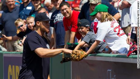 BOSTON, MA - JULY 15: Aaron Judge #99 of the New York Yankees gives a ball to a young fan before a game against the Boston Red Sox at Fenway Park on July 15, 2017 in Boston, Massachusetts. The Yankees won 4-1 in sixteen innings. (Photo by Rich Gagnon/Getty Images)