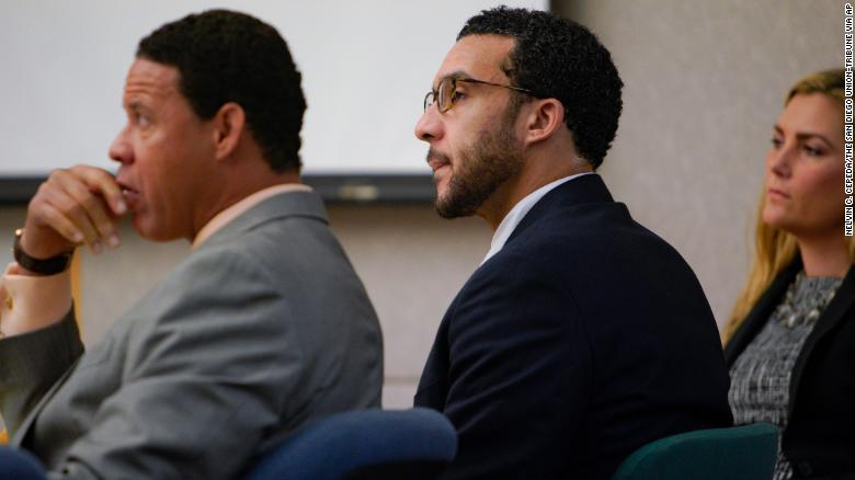 Flanked by defense attorneys, Kellen Winslow II watches closing arguments in his trial Tuesday.