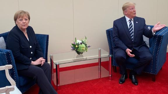 Trump meets with German Chancellor Angela Merkel on the sidelines of the D-Day event in Portsmouth.