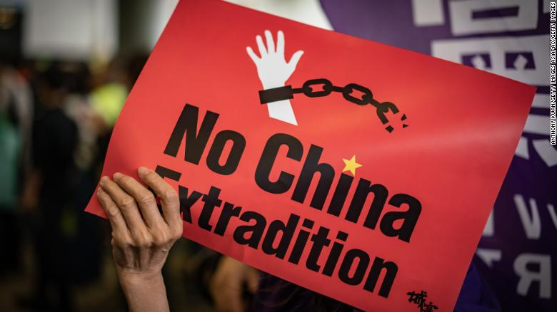 A protester holds a placard during a rally against the extradition law outside the Legislative Council building on May 4, 2019 in Hong Kong.