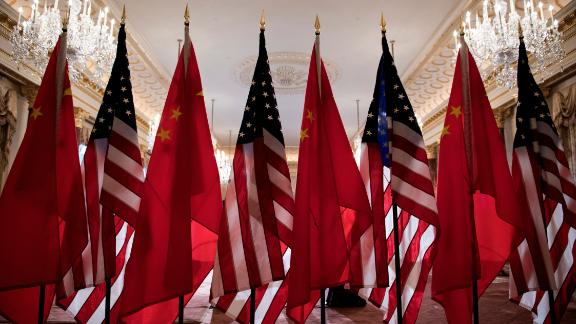 US and Chinese flags are seen as Secretary of State Mike Pompeo and China's Foreign Minister Wang Yi  meet at the US Department of State May 23, 2018 in Washington, DC. (Photo by Brendan Smialowski / AFP)        (Photo credit should read BRENDAN SMIALOWSKI/AFP/Getty Images)
