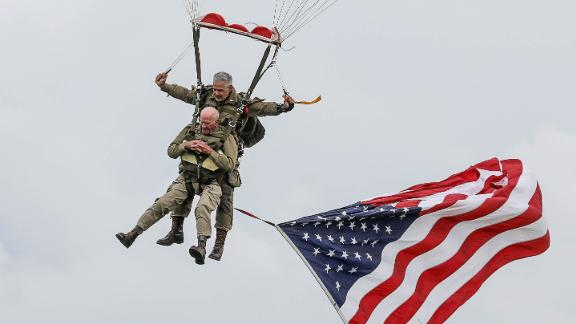 US WWII veteran Tom Rice (L) takes part in a parachute drop over Carentan, Normandy, north-western France, on June 5, 2019, as part of D-Day commemorations marking the 75th anniversary of the World War II Allied landings in Normandy. (Photo by LUDOVIC MARIN / AFP)        (Photo credit should read LUDOVIC MARIN/AFP/Getty Images)