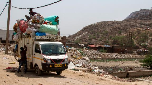 Lokesh collects plastic waste from the landfill to recycle into plastic sacks or slippers.