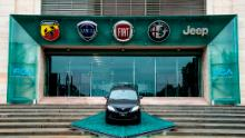 The logos of automobile companies (LtoR) Abarth, Lancia, Fiat, Alfa Romeo and Jeep are pictured at the entrance to the Fiat Chrysler Automobiles (FCA) at the Fiat Mirafiori car plant on May 27, 2019 in Turin, northern Italy. - French and Italian-US auto giants Renault and Fiat Chrysler are set to announce talks on an alliance, with a view to a potential merger, informed sources said on May 26, 2019. (Photo by MARCO BERTORELLO / AFP)        (Photo credit should read MARCO BERTORELLO/AFP/Getty Images)