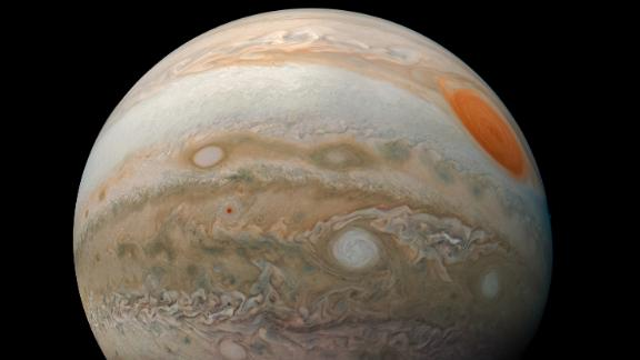 """In June, NASA has said that lucky viewers might get to """"glimpse a hint of the banded clouds"""" that surround Jupiter."""